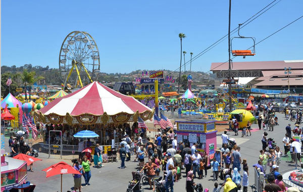 Dragon rides and ferris wheels are among the attractions at the opening of the Santa Clara County Fair, Thursday, Aug. 3, , in San Jose, California. (Karl Mondon/Bay Area News Group).