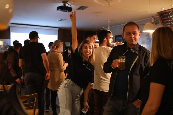 AWS User Group | Kosovo Meetup attendees socializing following presenation