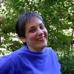 Laura E.