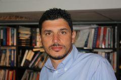 Huseyin E.