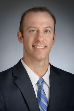 Dr. Justin C.
