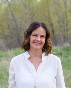 Janelle M.