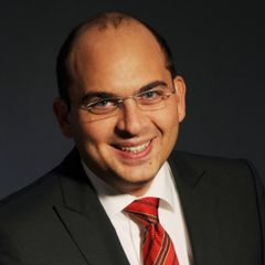 Murat E.