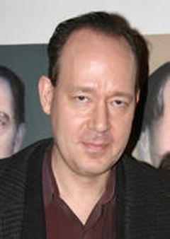 Ken E.