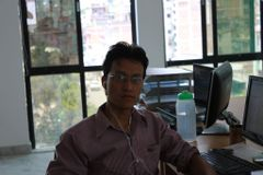 Dinesh M.