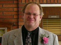 Marc E.