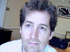 Neil E.