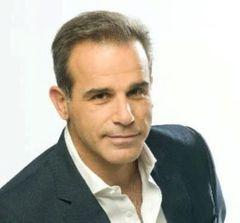 Manolis L