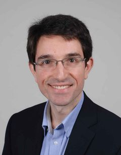 Adrian De L.