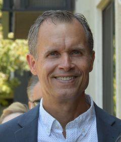 Adam E.