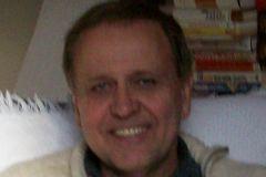 Ray E.