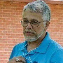 John E R.