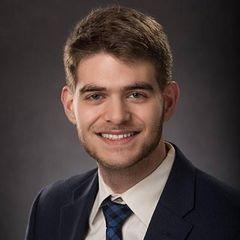 Aaron J G.