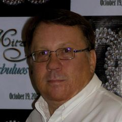 John E.