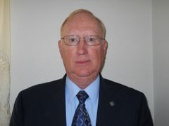 John E. S.