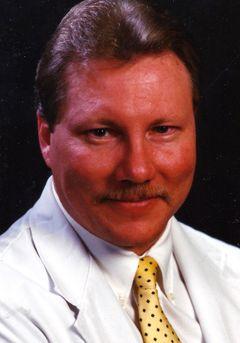 DR CARL A.