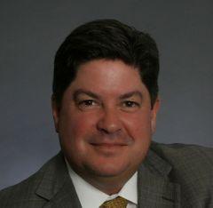 Gregory E. L.