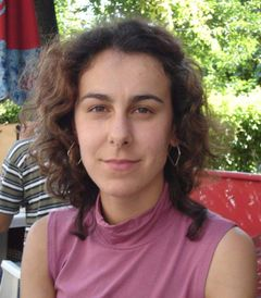 Corina A.