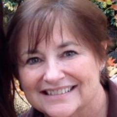 Mimi K C.