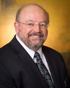 Dr. Martin J. B.
