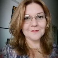 Cláudia F.
