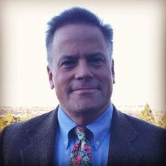 Mark E. R.