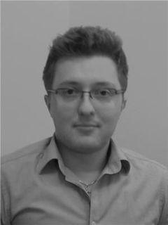 Lukasz R.