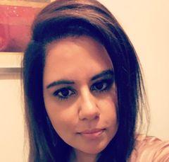 Nisha A