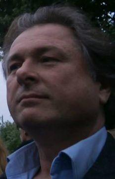 Giles B.